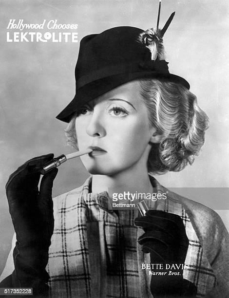 'Hollywood Chooses Lektrolite Bette Davis Warner Bros' Advertisement for an elegant cigarette lighter Undated illustration