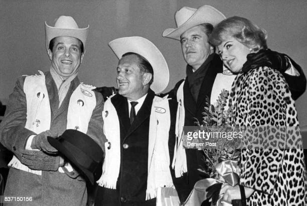 Hollywood Contingent Arrives For World Premiere Of 'Carpetbaggers' Robert Cummings Edward Dmytryk George Peppard and Martha Hyer from left get...