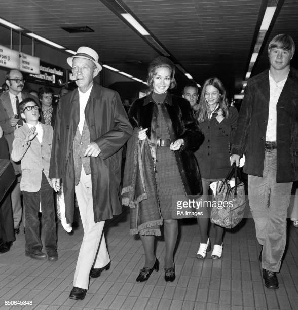 Hollywood crooner Bing Crosby who is known to his friends as Old Groaner arrives at Heathrow Airport from New York With him are his wife Katherine...