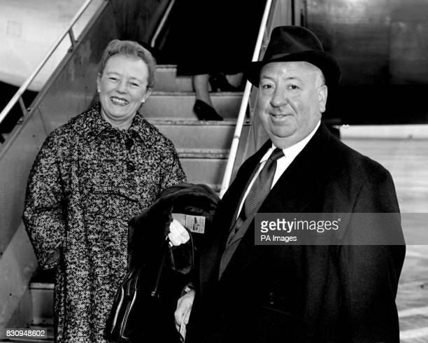 Hollywood film director Alfred Hitchcock and his wife are pictured as they boarded a Swissair plane for Zurich at London Airport
