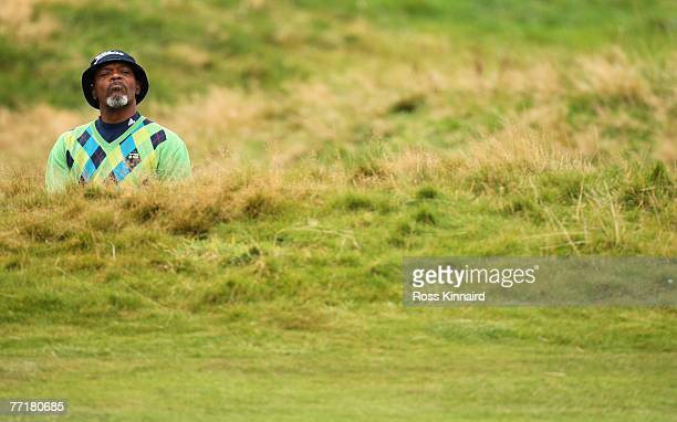 Hollywood film star Samuel L Jackson looks to see his ball after playing a stroke during the first round of the Alfred Dunhill Links Championship on...
