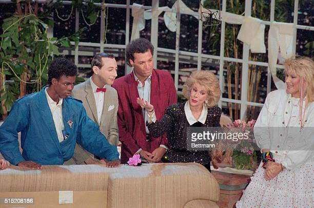 Holding her dog Spike and with fellow comics Chris Rock Pee Wee Herman and Howie Mandel at her side Joan Rivers ends her last show 5/15 as the...
