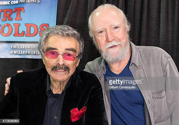 Hollywood Icon/actor Burt Reynolds poses with actor Scott Wilson as he makes his Wizard World Comic Con debut on day 3 of Wizard World Comic Con at...