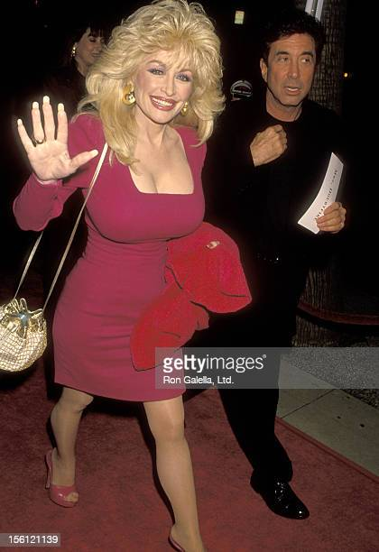 Hollywood Manager/Producer Sandy Gallin and Musician Dolly Parton attend the 'Mrs Doubtfire' Beverly Hills Premiere on November 22 1993 at Academy...