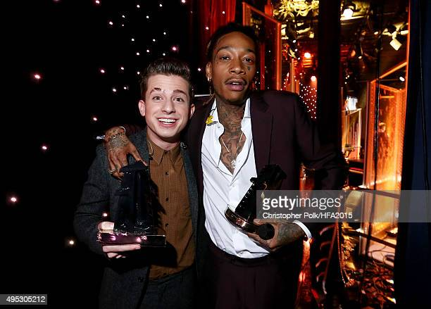Hollywood Song Award honorees Charlie Puth and Wiz Khalifa pose onstage at the 19th Annual Hollywood Film Awards at The Beverly Hilton Hotel on...