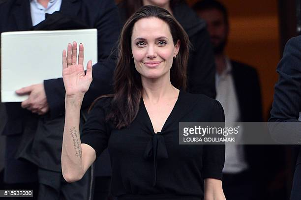 Hollywood star and UN refugee agency envoy Angelina Jolie gestures as she leaves the Greek Prime minister's office in Athens following a meeting with...