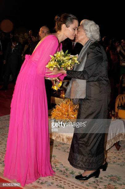 Hollywood star Angelina Jolie and former queen Monique kiss each others during the premiere of Jolie's new film 'First They Killed My Father' at the...