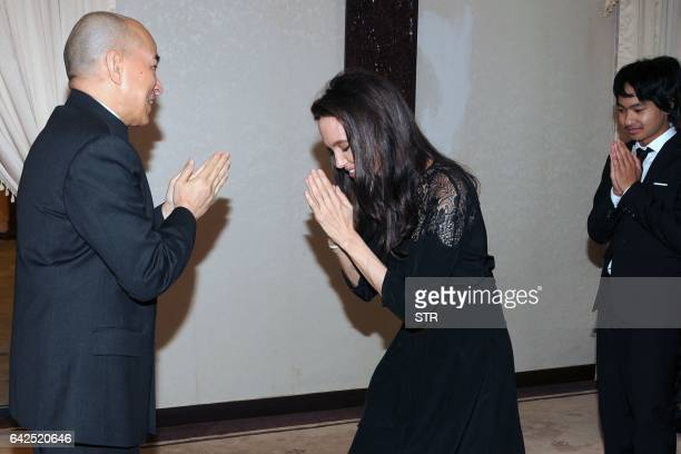 Hollywood star Angelina Jolie and Maddox JoliePitt pay their respects to Cambodian King Norodom Sihamoni during an audience at the royal residence in...