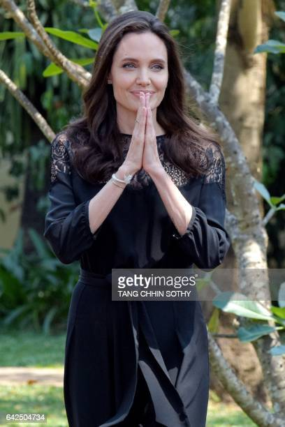 Hollywood star Angelina Jolie greets media during a press conference at a hotel in Siem Reap on February 18 2017 Angelina Jolie will unveil her new...