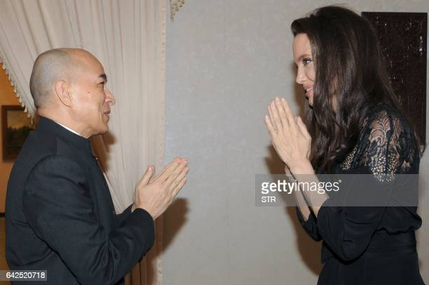 Hollywood star Angelina Jolie pays her respects during an audience with Cambodian King Norodom Sihamoni at the royal residence in Siem Reap on...