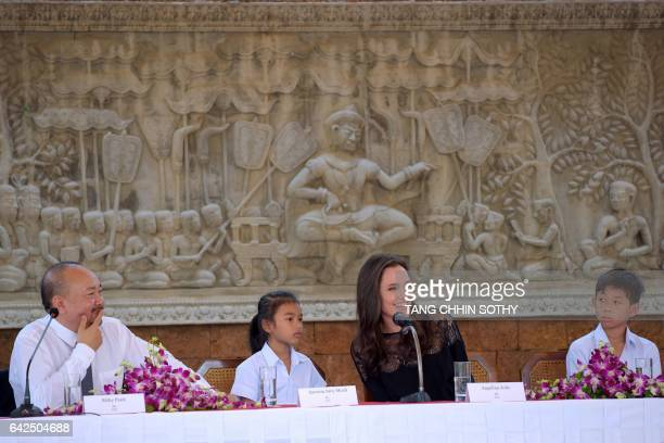 Hollywood star Angelina Jolie speaks as Cambodian film maker Rithy Panh with child actors Sareum Srey Moch and Mun Kimhak look on during a press...