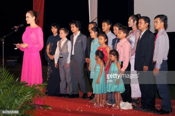 Hollywood star Angelina Jolie speaks as her children and actors of her new film stand on a stage during the premiere of Jolie's new film 'First They...