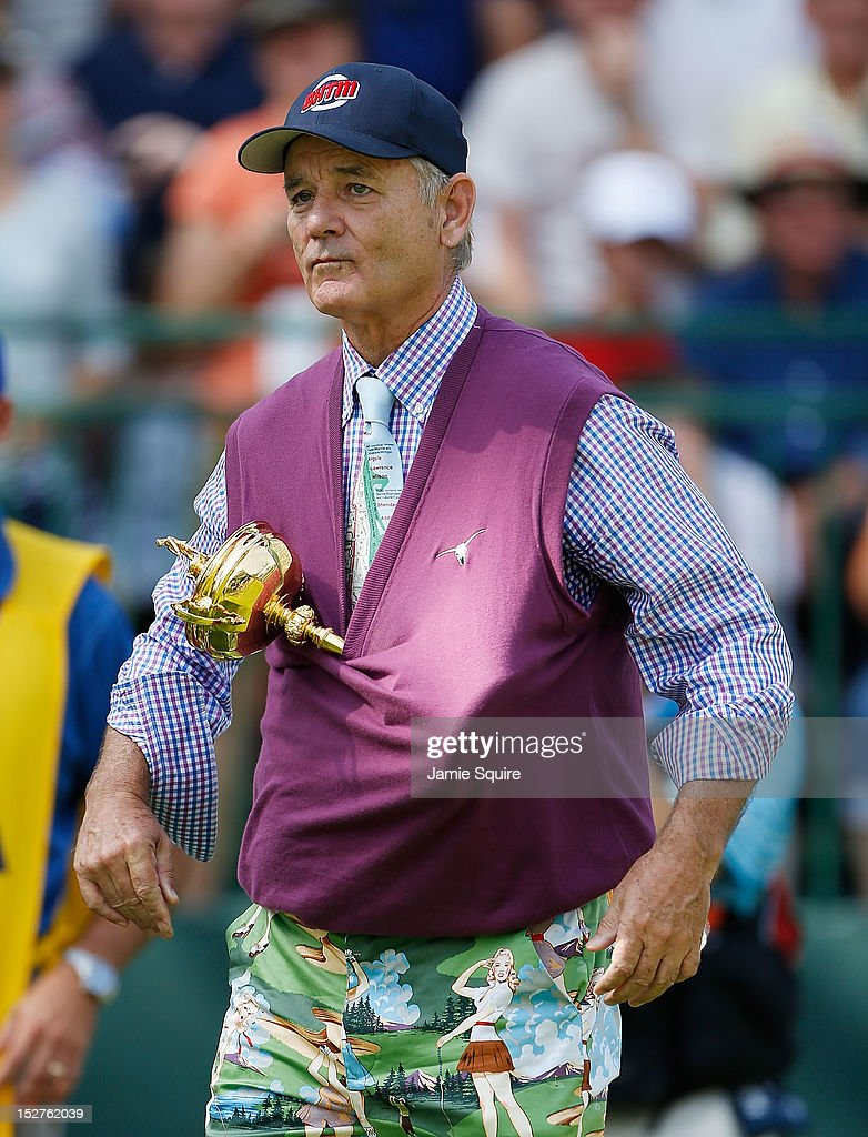 Hollywood star Bill Murray clowns around with the Ryder Cup on the first tee during the 2012 Ryder Cup Captains & Celebrity Scramble at Medinah Country Golf Club on September 25, 2012 in Medinah, Illinois.