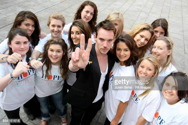 Hollywood star Jonathan RhysMeyers meets schoolgirl volunteers from Alexandra College Milltown in the Clarence Hotel in Dublin as he revealed his...