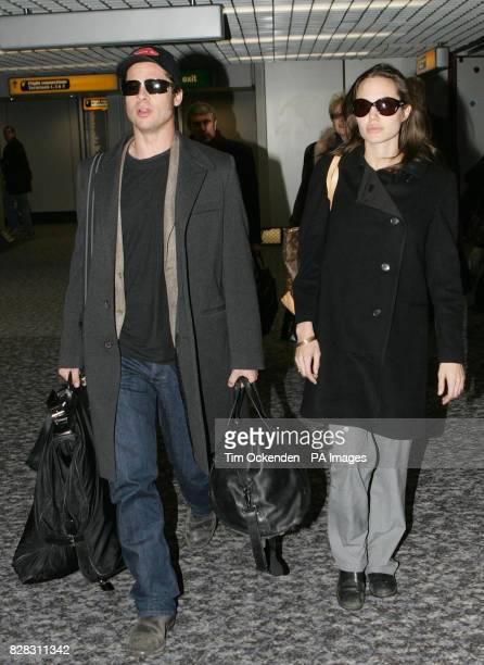 Hollywood stars Brad Pitt and Angelina Jolie at Heathrow Airport after flying from Zurich Saturday January 28 2006 Jolie who is a goodwill ambassador...