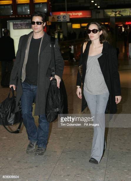 Hollywood stars Brad Pitt and Angelina Jolie at ondon's Heathrow Airport where they are due to leave the UK on a flight to Zurich Wednesday January...