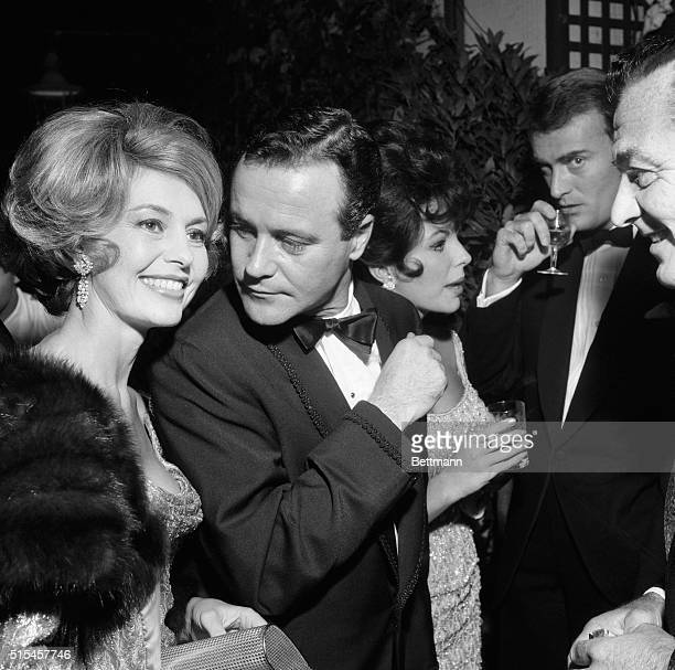 Hollywood stars Cyd Charisse Jack Lemmon and Joan Collins enjoy themselves during a party at the Grand Hotel in Rome October 14th The huge party...