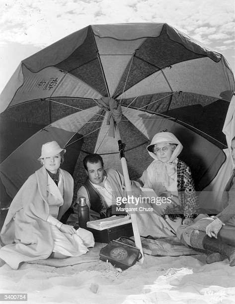 Hollywood stars Myrna Loy Ramon Novarro and Louise Closser Hale relax in the sun during takes for the MetroGoldwynMayer production 'The Barbarian'