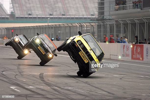 A Hollywood stunt actor performs atop a car driving at the Shanghai International Circuit on March 12 in Shanghai China The Hollywood stunt team...