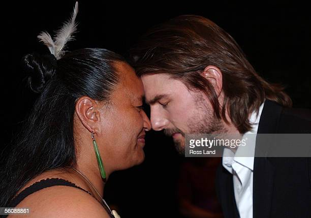 Hollywood super star Tom Cruise performs a hongi with Wahine Alice Pomare during a Powhiri prior to a press conference for the 'Last Samurai' movie...
