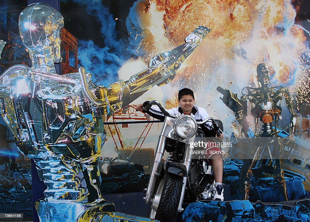 A young boy sits on Arnold Schwarzenegger's motorbike used in Terminator at Universal Studios in Hollywood 09 April 2007 Universal Studios Hollywood...