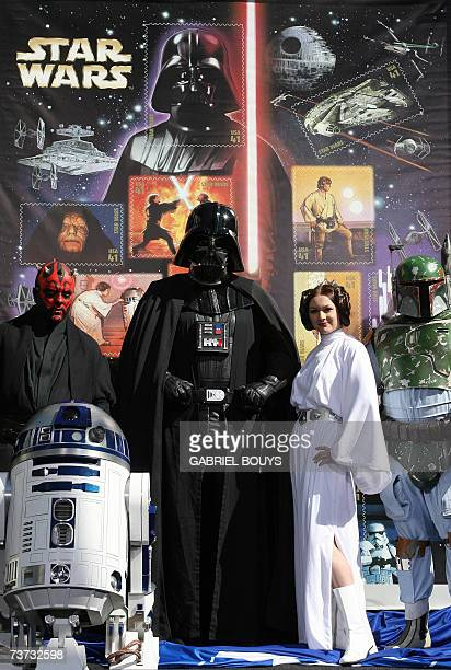 Star Wars characters pose in front of the new US forty one cent postage stamps unveiled 28 March 2007 at the Chinese Theater in Hollywood where the...
