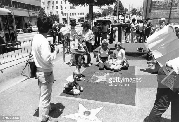 Hollywood Walk of Fame tourists at the site where a new star for Canadian pop singer Anne Murray was embedded into the sidewalk