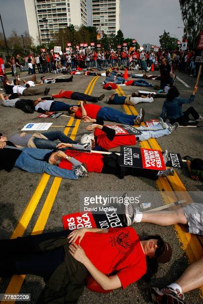 Hollywood writers lie down on Pico Boulevard to form the letters WGA for news helicopters above as more than 3000 movie and television writers and...