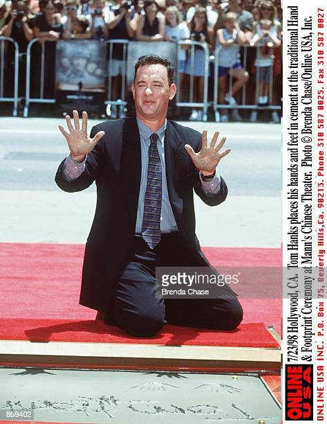 Hollywoof CA Tom Hanks places his hands and feet in cement at the traditional Hand Footprint Ceremony at Mann's Chinese Theater