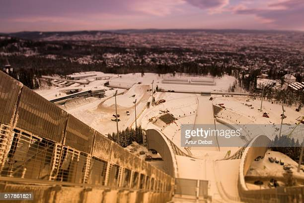 Holmenkollen ski jump at sunset with nice architecture and snowy landscape with the cityscape of Oslo Norway Europe