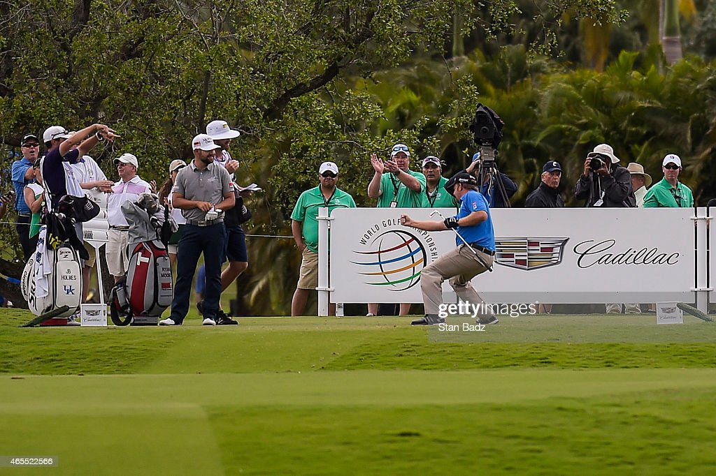 B Holmes celebrates a holeinone on the fourth hole tee box during the third round of the World Golf ChampionshipsCadillac Championship at Blue...