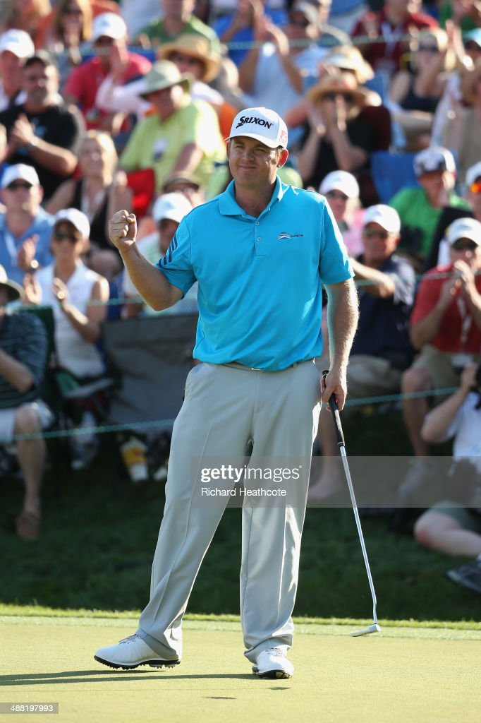 Holmes celebrates holing the winning putt on the 18th green to secure victory in the final round of the Wells Fargo Championship at the Quail Hollow...