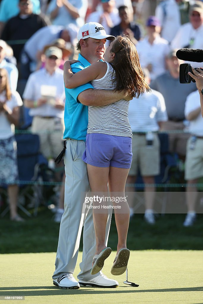 Holmes celebrates victory with his wife Erica after holing the winning putt during the final round of the Wells Fargo Championship at the Quail...