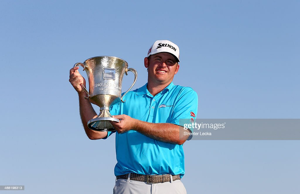 B Holmes celebrates with the trophy after winning the Wells Fargo Championship in the final round on May 4 2014 in Charlotte North Carolina