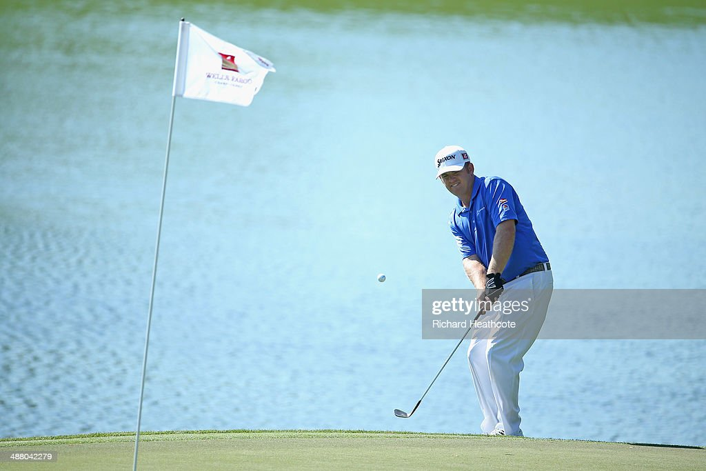 Holmes chips onto the 14th green during the third round of the Wells Fargo Championship at the Quail Hollow Club on May 3 2014 in Charlotte North...