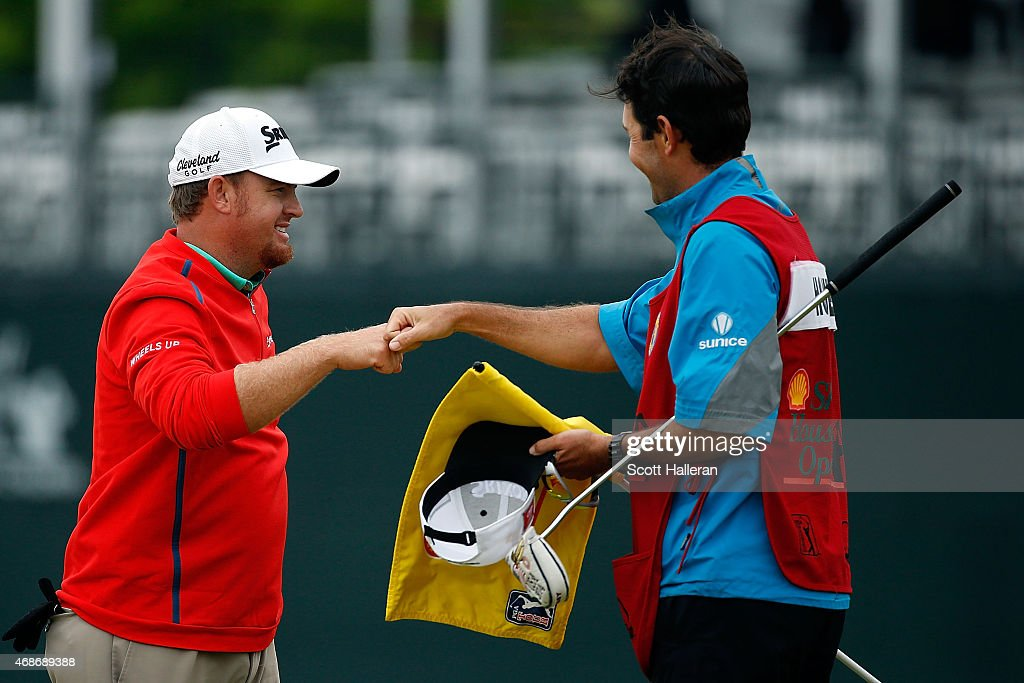 B Holmes congratulates his caddie after winning the Shell Houston Open at the Golf Club of Houston on the second hole of a playoff on April 5 2015 in...