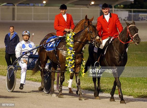 Holmes DG driven by Barry Purden returns to the winners circle after leading the field home in the 2001 Friday Flash Auckland Cup in a world record...
