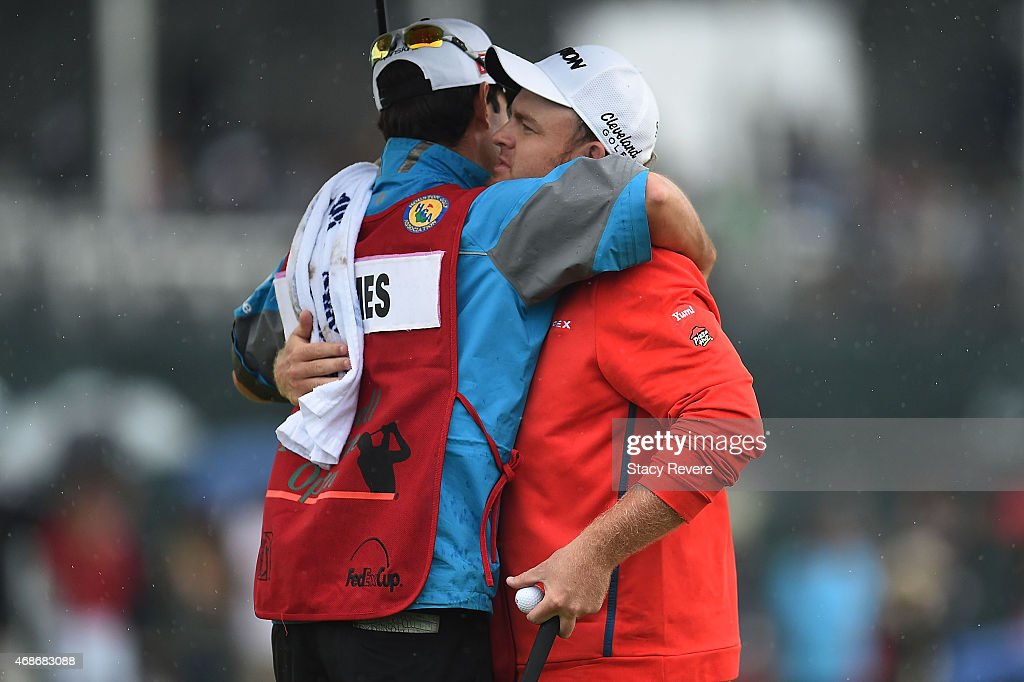 B Holmes embraces his caddie following an eightunder par 64 in the final round of the Shell Houston Open at the Golf Club of Houston on April 5 2015...