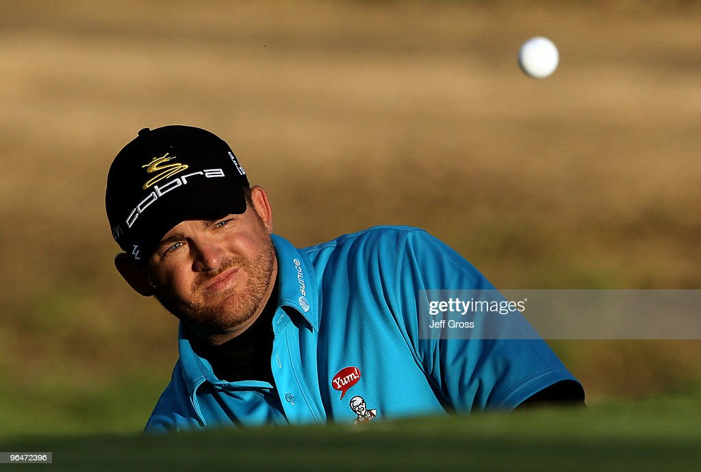 B Holmes hits a pitch shot to the 13th green during the third round of the Northern Trust Open at Riviera Country Club on February 6 2010 in Pacific...