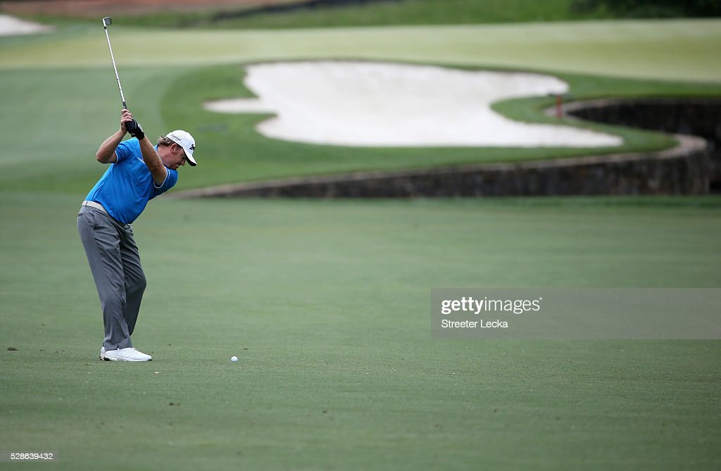 <a gi-track='captionPersonalityLinkClicked' href=/galleries/search?phrase=J.B.+Holmes&family=editorial&specificpeople=491000 ng-click='$event.stopPropagation()'>J.B. Holmes</a> hits a shot on the fifth hole during the second round of the 2016 Wells Fargo Championship at Quail Hollow Club on May 6, 2016 in Charlotte, North Carolina.