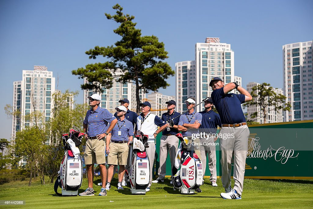 J.B. Holmes of Team USA tees off on the seventh hole as caddies and teammates (L-R) Brandon Parsons, John Wood, Bill Haas, Captain Jay Haas, Captain's Assistant Steve Stricker, Ted Scott and Bubba Watson look on during practice for The Presidents Cup at Jack Nicklaus Golf Club Korea on October 5, 2015 in Songdo IBD, Incheon City, South Korea.