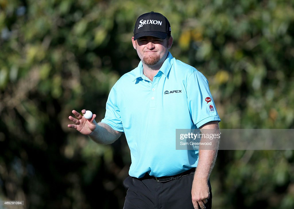 B Holmes of the United States acknowledges the crowd after making birdie on the seventh hole during the first round of the World Golf...