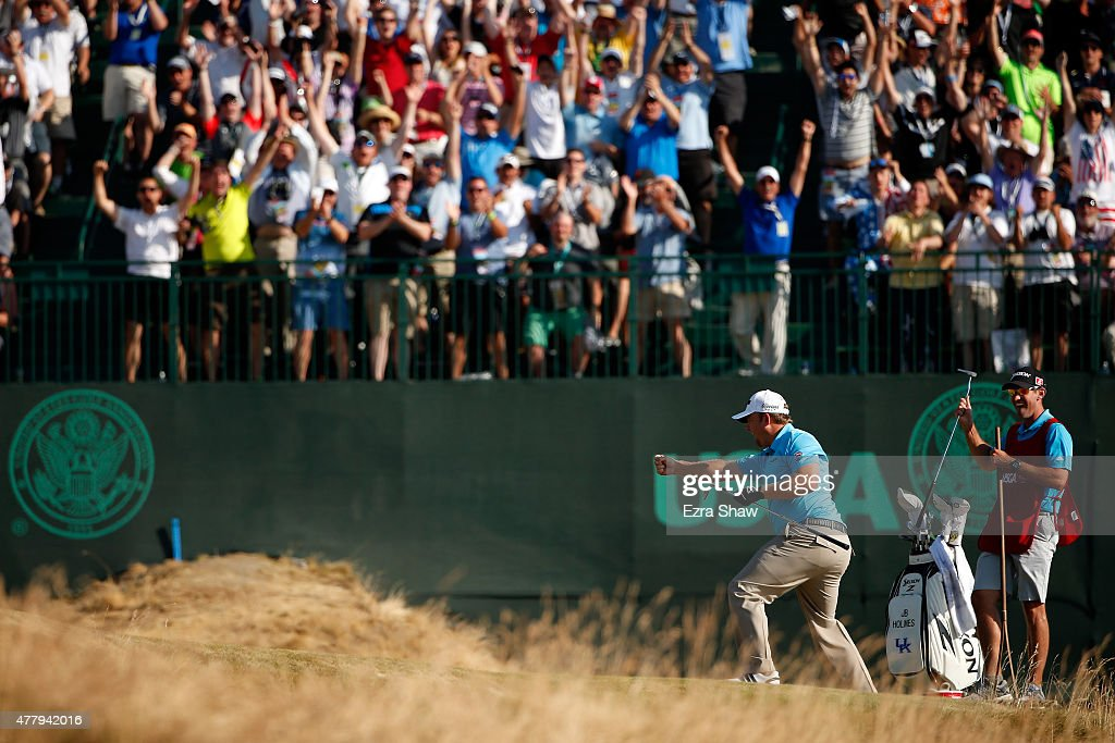 J.B. Holmes of the United States celebrates after holing out for eagle on the 16th hole during the third round of the 115th U.S. Open Championship at Chambers Bay on June 20, 2015 in University Place, Washington.