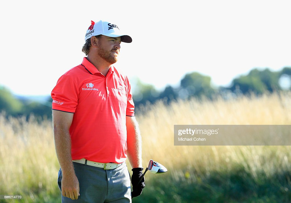B Holmes of the United States looks on from the tee on the third hole during the second round of the Travelers Championship at the TPC River...