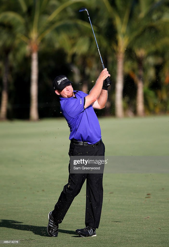 B Holmes of the United States plays a shot on the 14th hole during the second round of the World Golf ChampionshipsCadillac Championship at Trump...