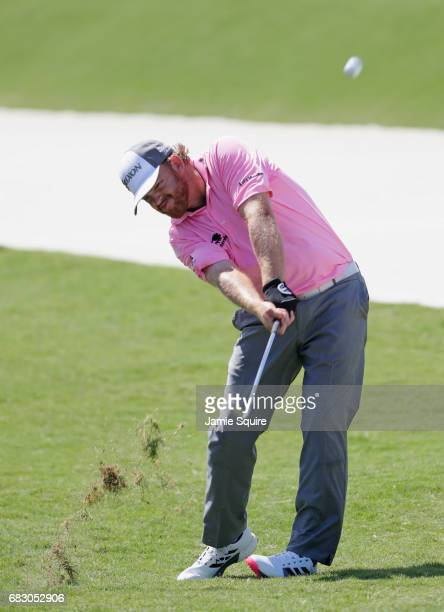 B Holmes of the United States plays a shot on the fifth hole during the final round of THE PLAYERS Championship at the Stadium course at TPC Sawgrass...