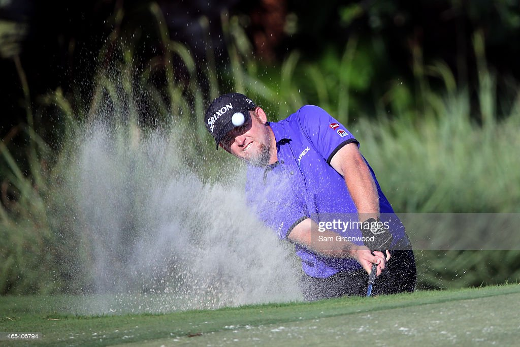 J. B. Holmes of the United States plays a shot out of the bunker on the thirteenth hole during the second round of the World Golf Championships-Cadillac Championship at Trump National Doral Blue Monster Course on March 6, 2015 in Doral, Florida.