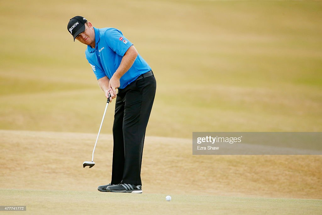 B Holmes of the United States putts on the fifth green during the second round of the 115th US Open Championship at Chambers Bay on June 19 2015 in...