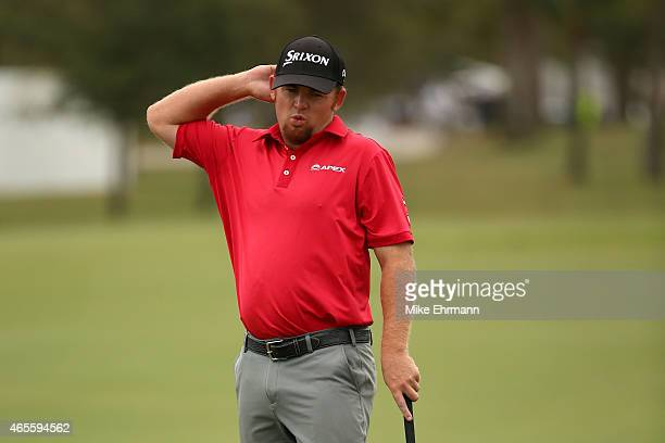 J B Holmes of the United States reacts after missing a birdie putt on the first hole during the final round of the World Golf ChampionshipsCadillac...