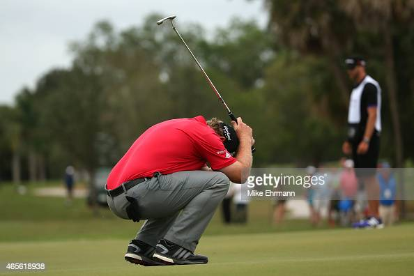 J B Holmes of the United States reacts after missing a birdie putt on the seventeenth hole green to place second in the final round of the World Golf...